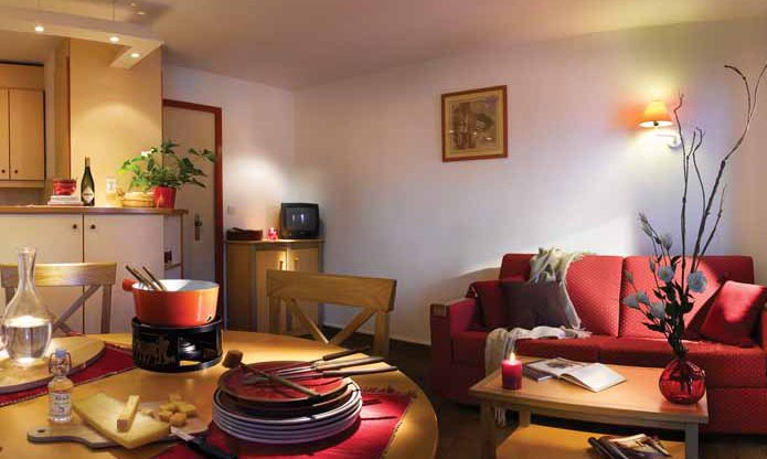 The living and dining area in the Ravines apartments Meribel