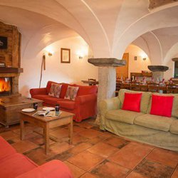 Living Room and Dining Room with Roaring Fire