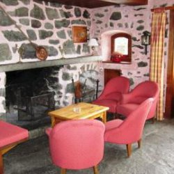 Living area with fireplace in Chalet Altitude 1600 in Meribel