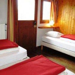 Triple bedroom in Chalet Altitude 1600 in Meribel