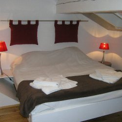 One of the double bedrooms in apartment Le Centre in Meribel