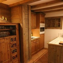 Kitchen area in apartment Jardin d'Hiver
