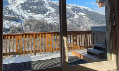Balcony and hot tub at Chalet Chardon in Meribel