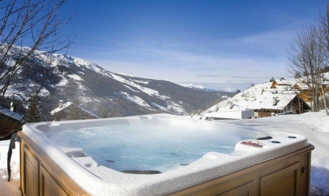Luxury hot tub with magnificent views at Club Chalet Pierre