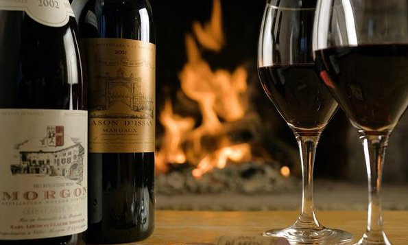 Glass of Wine with a Roaring Fire