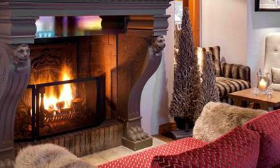 Roaring Fire and Comfortable Sofas