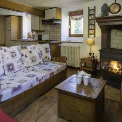 Chalet La Coblette Living Room with Roaring Fire