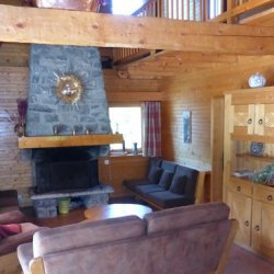 Comfortable living room with fireplace in Chalet La Renarde