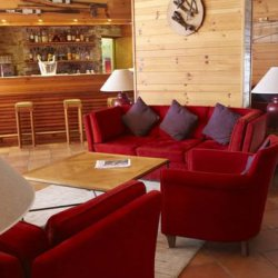 Lounge and bar area in Club Med Le Chalet Meribel