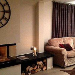 Cosy living room and fireplace in Chalet Montee Meribel