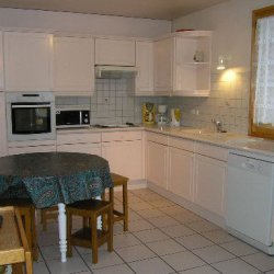 Spacious kitchen area in Chalet Vent de Galerne in Meribel