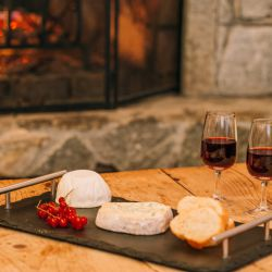 Cheese and wine beside the fire